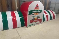 Red, white, and green striped awning for ice cream shop