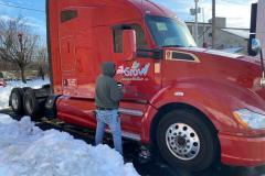 Red semi truck car wrap installation in Bethlehem, PA, view 2