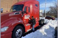 Red semi truck car wrap installation in Bethlehem, PA, view 1
