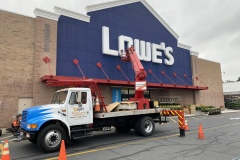 Channel Letters for Lowe's being installed by D-Signs & Awnings, Inc.