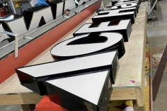 Channel letters being manufactured for Ace Hardware