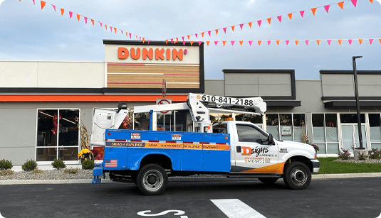 D-signs truck in front of channel letter sign in Coopersburg for Dunkin'