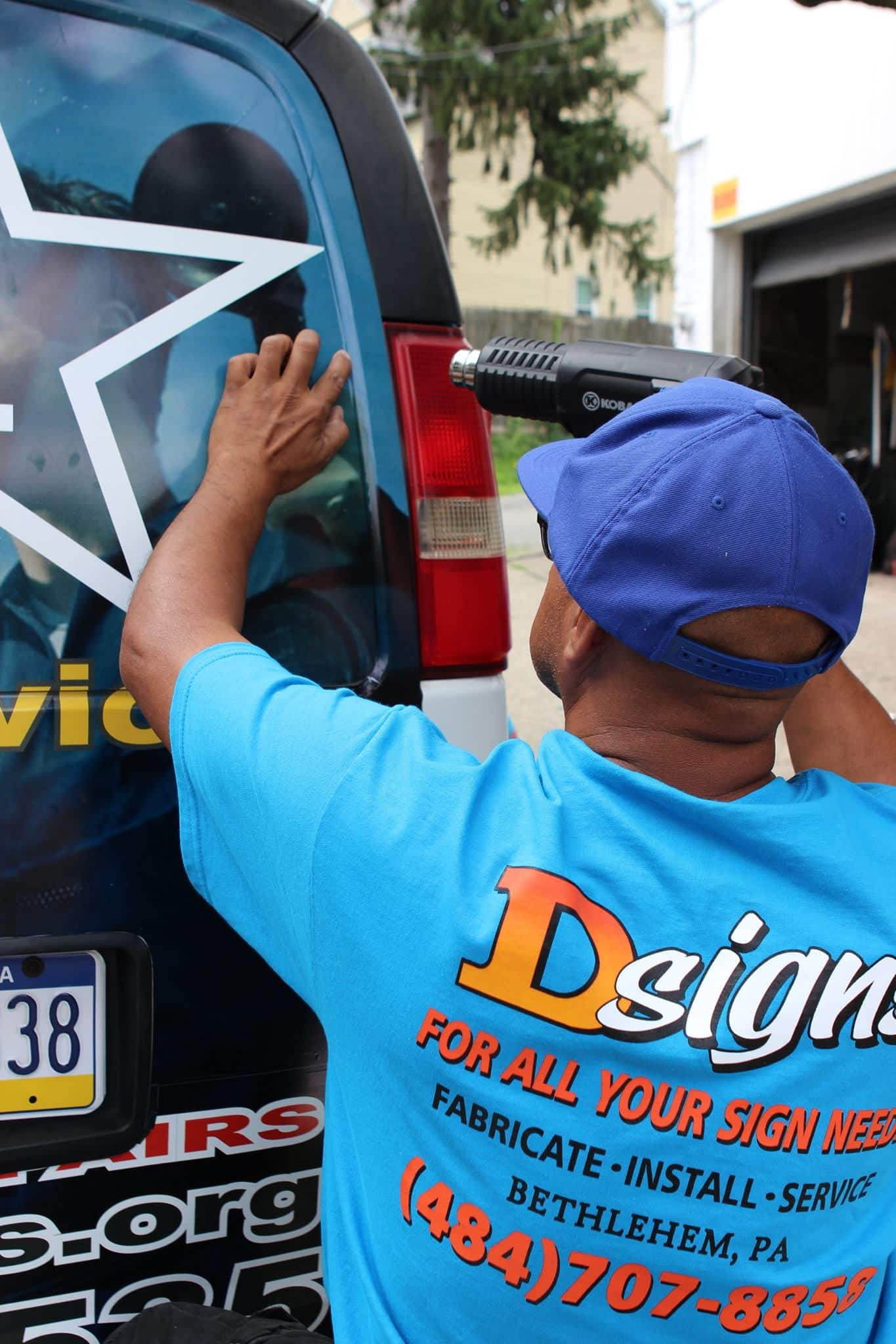 D-Signs & Awnings technician applying a car wrap in Phillipsburg, NJ